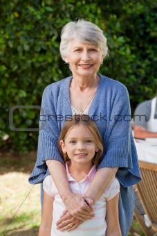 Grandmother with her granddaughter looking at the camera in the