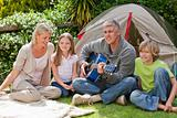 Happy family camping in the garden