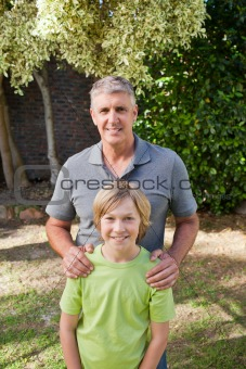 Boy with his Grandfather looking at the camera