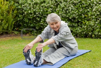 Senior woman doing her streches