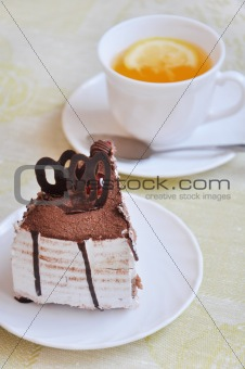 A delicious slice of cake with a cup of tea