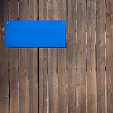 Wooden wall  with blue plate on it