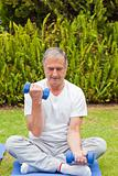 Retired man doing his exercises in the garden