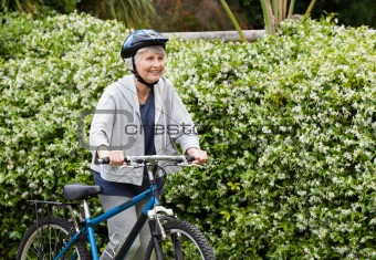 Mature woman walking with her mountain bike