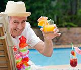 Mature man drinking a cocktail
