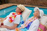 Retired couple sleeping beside the swimming pool