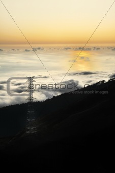 Electricity pylon over valley at sunset, Lomba das Torres,  Madeira island, Portugal