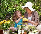 Happy Grandmother with her granddaughter working in the garden