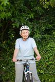 Mature woman mountain biking outside