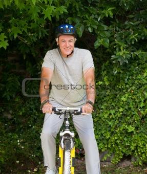 Mature man mountain biking outside