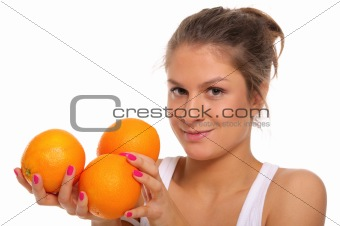 Beautiful smiling woman with oranges