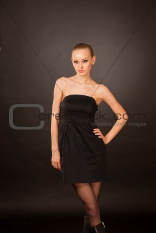 Elegant caucasian girl in black dress