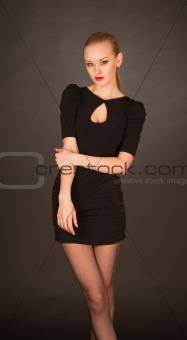 Girl with red lips and in black cocktail dress