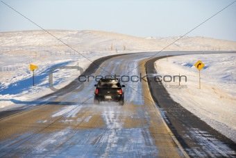 Automobile on icy road.