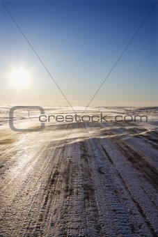 Tire tracks on icy road.