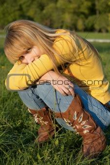 blond girl squatting