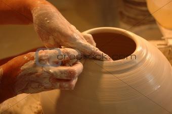 Potter's hands creating new ceramic vase