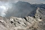 Lonely man walking on the edge of volcano