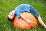 Boy Playing on Pumpkin