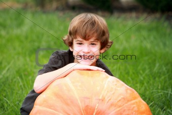 Boy and Large Pumpkin