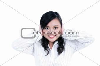 Attractive businesswoman covering ears with her hands