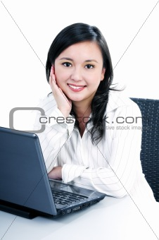 Happy young businesswoman with laptop