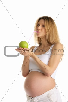 pregnant woman drinking juice from apple