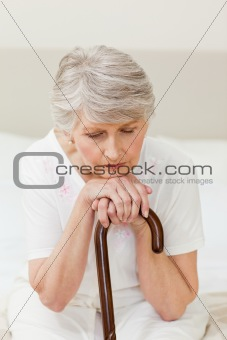 Retired woman with her walking stick