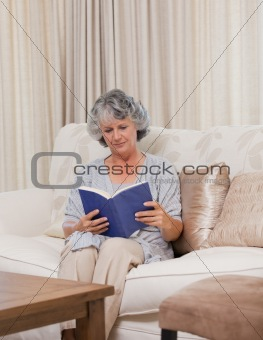 Senior woman reading her book