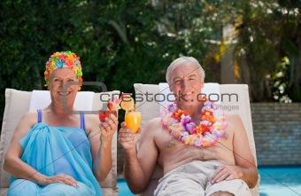 Happy senior couple drinking cocktails