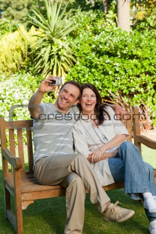 Lovers taking a photo of themselves in the garden