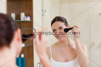 Beautiful women putting make up on