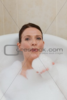 Beautiful woman taking a bath