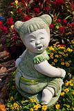 Child statue in the garden.
