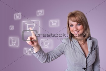 woman pressing shopping cart icon