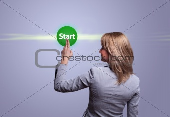 woman hand pressing green START button