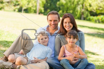 Family sitting in the park