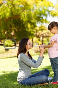 Joyful mother with her daughter in the park