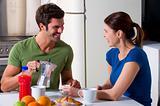couple having breakfast in the kitchen