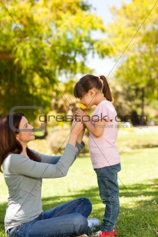 Beautiful mother with her daughter in the park