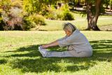 Mature woman doing her streches in the park