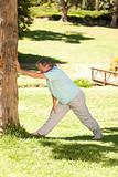 Mature man doing his streches in the park