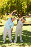 Mature couple doing their streches in the park