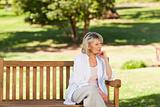 Senior woman thinking on the bench
