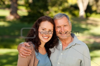 Woman with her father-in-law in the park