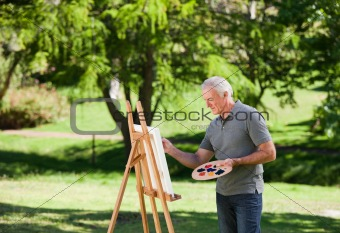 Senior man painting