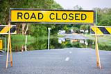 Road closed traffic sign on a flooded road