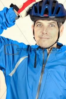 Cyclist Puts On Helmet