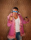 Man in Pink Jacket Listens to Music