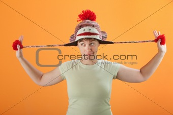 Woman Plays with Her Cap